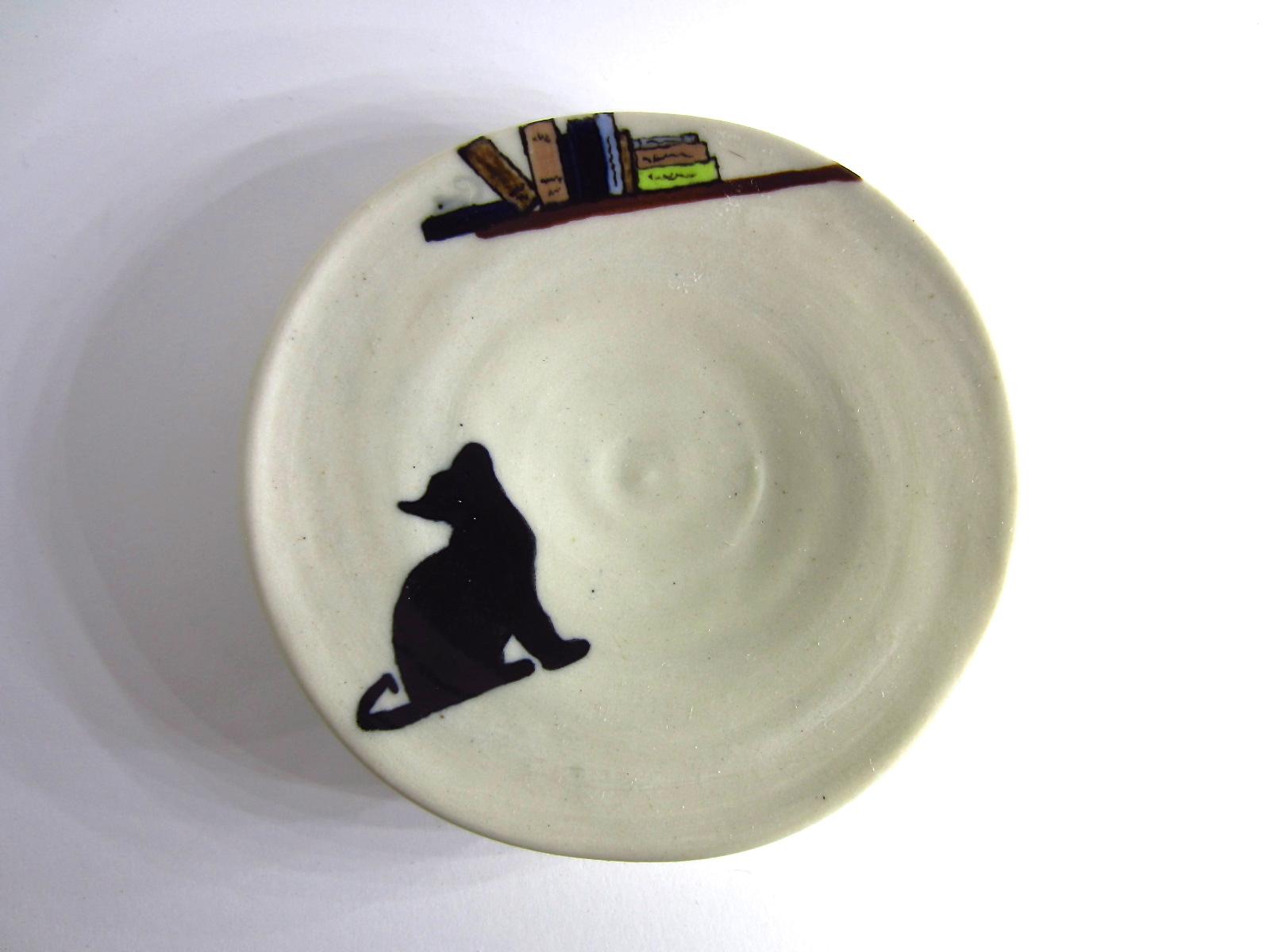 cat in a plate 9